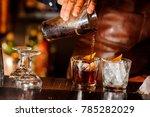 barman pouring fresh alcoholic... | Shutterstock . vector #785282029