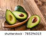 avocado on old wooden table... | Shutterstock . vector #785296315
