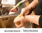 woman peeling potatoes over a...   Shutterstock . vector #785296504