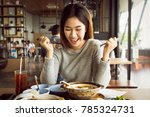 happy asian teenage woman is... | Shutterstock . vector #785324731