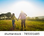 two sisters running on the lawn ...   Shutterstock . vector #785331685