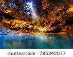 beam of light shines through an ... | Shutterstock . vector #785342077