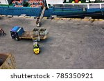 dock workers preparing to off... | Shutterstock . vector #785350921