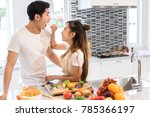 couple together in kitchen room ... | Shutterstock . vector #785366197