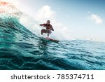 young surfer rides the wave.... | Shutterstock . vector #785374711