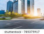 blurred empty road and modern... | Shutterstock . vector #785375917