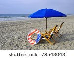 Beach Chairs And Umbrellas By...