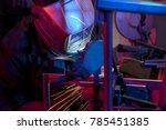 welder erecting technical steel.... | Shutterstock . vector #785451385