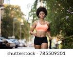 woman jogger doing cardio... | Shutterstock . vector #785509201