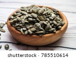 raw pumpkin seeds  food... | Shutterstock . vector #785510614