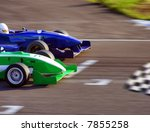 Two Formula Cars Speeding To...
