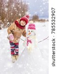 a child in the winter in the... | Shutterstock . vector #785532907
