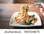 pasta   spaghetti stired with... | Shutterstock . vector #785534875