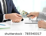 businessman taking bribe from... | Shutterstock . vector #785540317