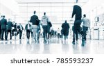 blurred people at a trade fair | Shutterstock . vector #785593237