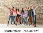 group of cool teenagers taking... | Shutterstock . vector #785600524