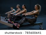 women training rowing in gym... | Shutterstock . vector #785600641