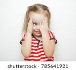 funny little girl that cheats... | Shutterstock . vector #785641921