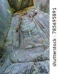 Small photo of Mount Nokogiri (Nokogiriyama) Hyaku-shaku Kannon (Hundred-shaku Kannon) tall relief image of Kannon deity (Goddess of mercy) carved into an old edo period quarry wall.