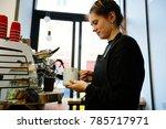 hipster female barista enjoying ... | Shutterstock . vector #785717971