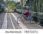 Tricycle in old bridge - stock photo