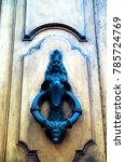 a knocker mounted on a door in... | Shutterstock . vector #785724769