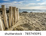 Wooden Post On The Beach...