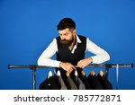 tailor with curious face near... | Shutterstock . vector #785772871