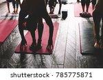 sweating people practicing yoga ... | Shutterstock . vector #785775871