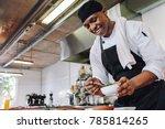 gourmet chef in uniform cooking ... | Shutterstock . vector #785814265