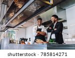 smiling restaurant owner and... | Shutterstock . vector #785814271