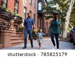 family taking a walk down the... | Shutterstock . vector #785825179