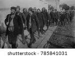 Small photo of Turkish prisoners, led by an armed guard, enter Vrania, Serbia. During the First Balkan War, 1912-1913, Bulgaria, Serbia, Greece and Montenegro, united in the Balkan League, to push the weakened Ottom
