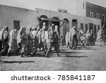 Small photo of Arab prisoners of war walking in Tripoli, Libya, with Italian soldiers during the Italo-Turkish War. The Italian invasion of 100,000 soldiers was resisted by a small force of 20,000 Arabs and 8,000 Tu