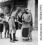 Small photo of British soldier checking papers and searching Arabs for arms at the Jaffa Gate, Jerusalem. 1936 during the Arab Revolt