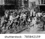 young male rioters charging a... | Shutterstock . vector #785842159