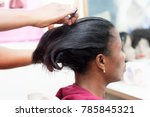 Small photo of The hairdresser comb the hair of her client before proceeding to put the shap of her hair