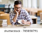 serious male student reading... | Shutterstock . vector #785858791