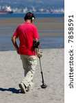 Man With Metal Detector At The...