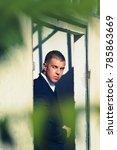 handsome man in black suit and... | Shutterstock . vector #785863669