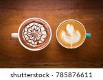 two cups of coffee on wooden... | Shutterstock . vector #785876611