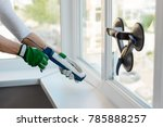 hands applying silicone sealant ... | Shutterstock . vector #785888257