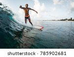 young surfer rides the wave.... | Shutterstock . vector #785902681