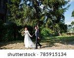 wedding couple walking around... | Shutterstock . vector #785915134