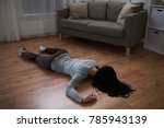 Small photo of murder, kill and people concept - unconscious or dead woman body lying on floor at crime scene (staged photo)