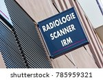 "Small photo of Closeup on Sign on a building indicating radiology, MRI and medical scan services (""Radiologie Scanner IRM"" in French)"