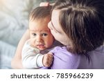 happy caring mother holding...   Shutterstock . vector #785966239