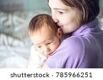 happy caring mother holding... | Shutterstock . vector #785966251