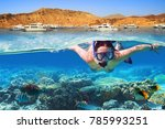 young woman at snorkeling in... | Shutterstock . vector #785993251