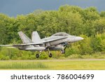 Small photo of PETERBOROUGH, ON, CANADA - JULY 14, 2017: A Canadian Forces CF18 lands at Peterborough airport. The aircraft was part of Peterborough's Canada 150 celebrations.